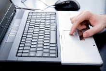Male hand on a notebook touchpad