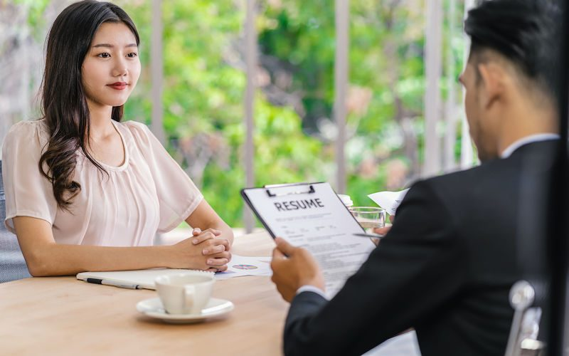 Young Asian woman graduate interviewing with two manager with positive motion in meeting room,Business Hiring new member, Job interview with manager concept