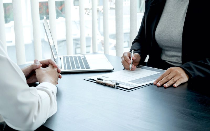 Business people hold a job profile and talk to job applicants for job interviews about careers and business concepts.