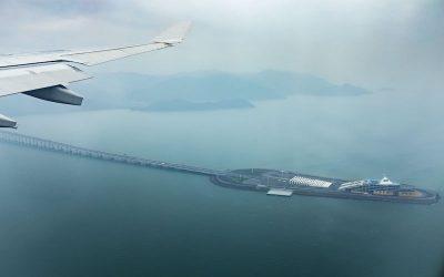 aerial view from plane window of hong kong - juhai - macau bridge crossing ocean harbor