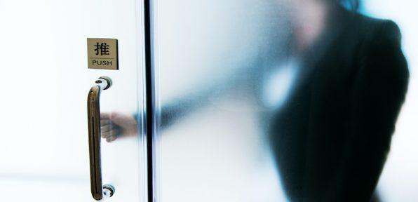 Businesswoman hand opening office door