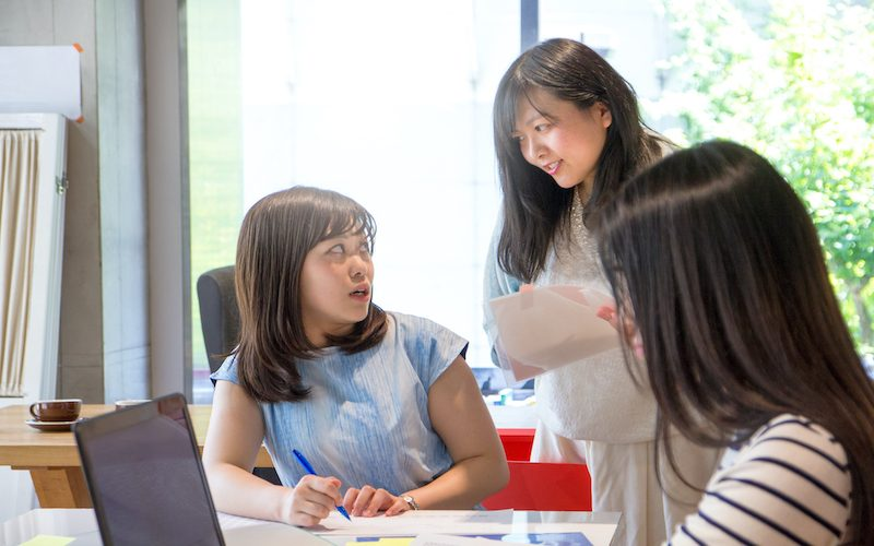 Japanese Businesswomen Working Together at a Modern Coworking Space
